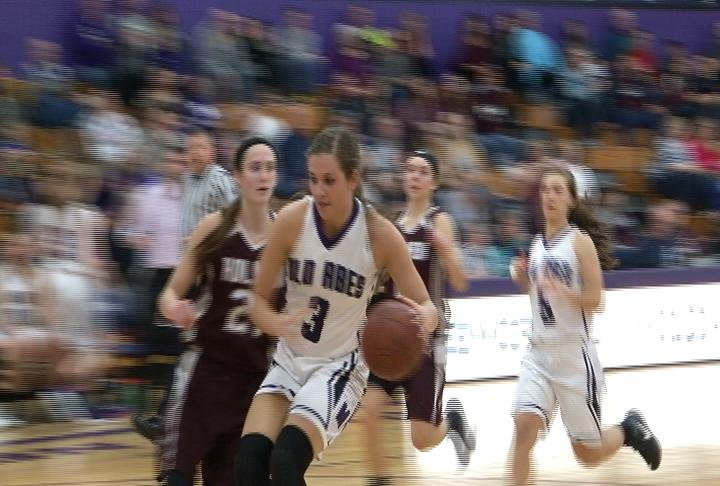 EC Memorial's Jada Biermeier goes to the hoop in a win over Holmen