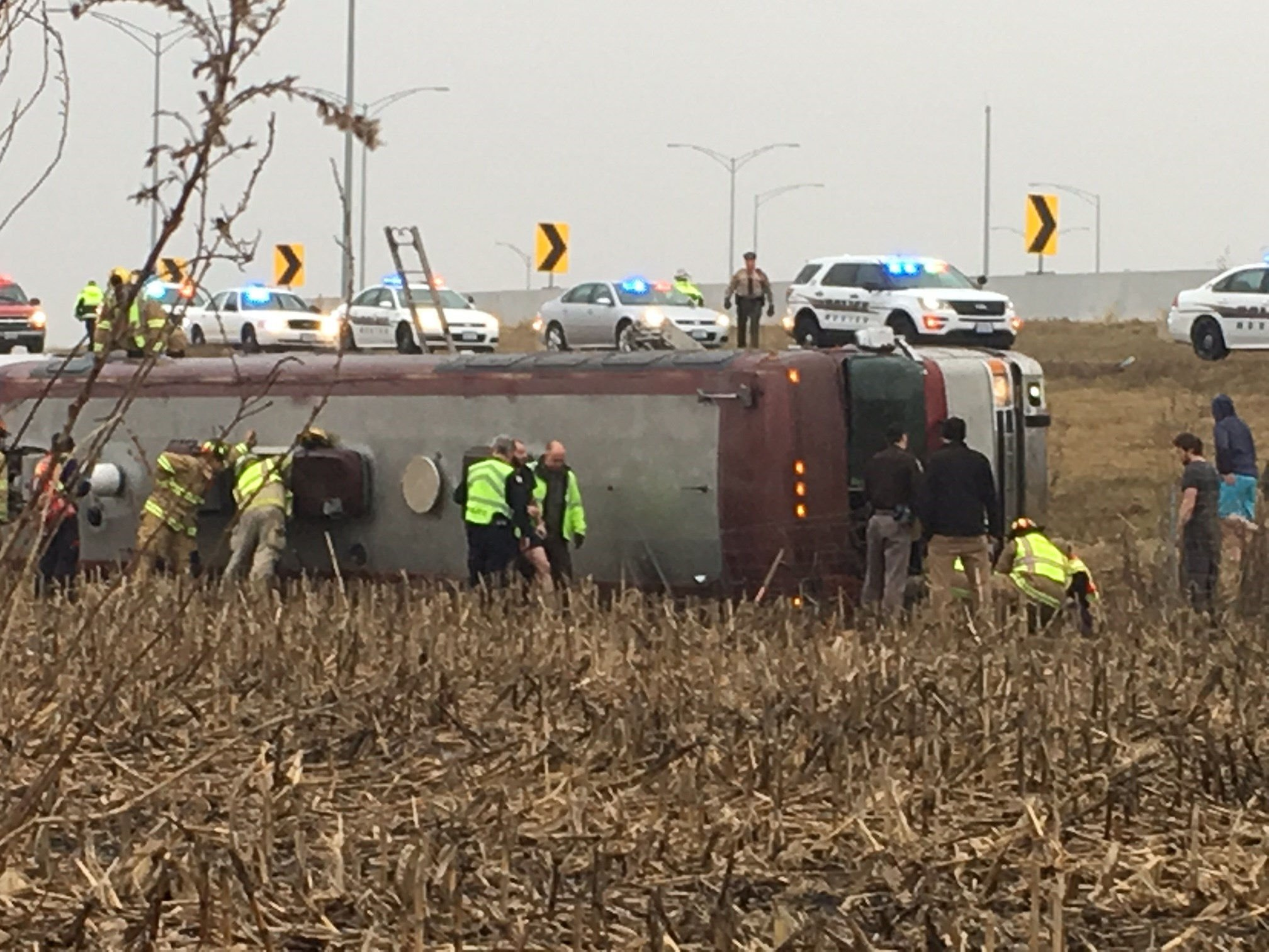 Minor league hockey team bus rolls over; 3 seriously injured