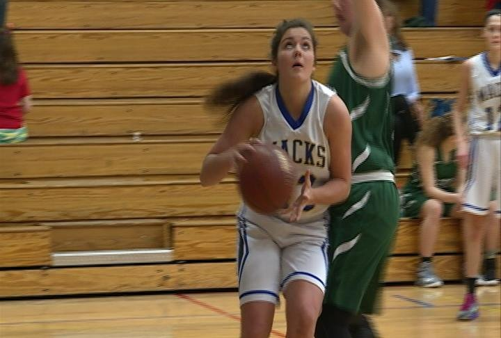 Andrea Hiess scores a tough basket as the Macks win