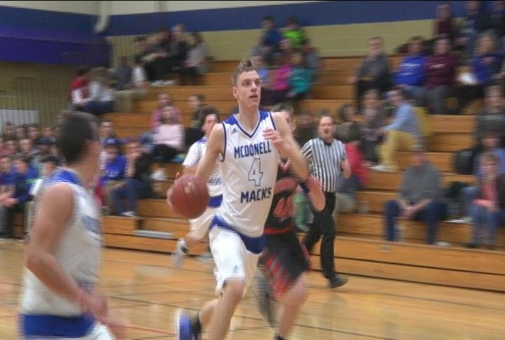 Alex Ohde glides to the bucket as McDonell defeats Osseo-Fairchild