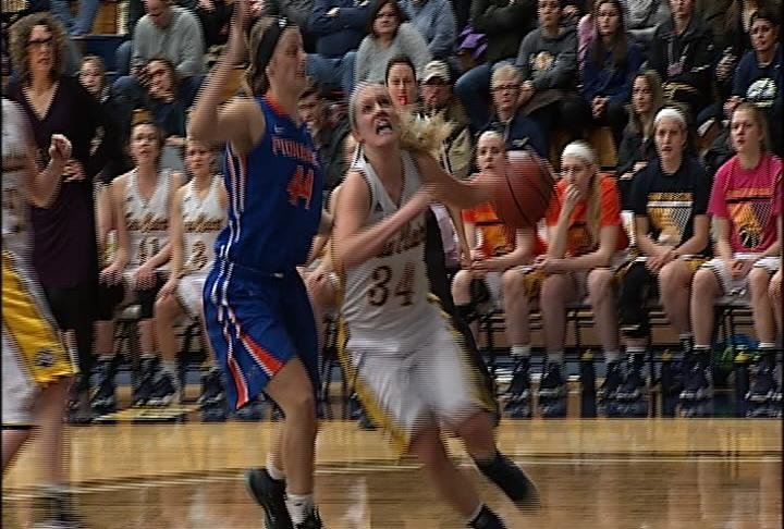 Arien Brennan drives for 2 of her 12 points as UWEC defeats UWP