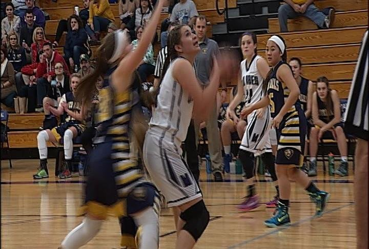Jada Biermeier goes up for 2 points as EC Memorial beats River Falls