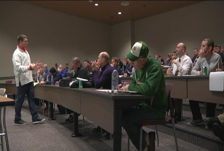 Jim Leonhard talks to area HS & college coaches