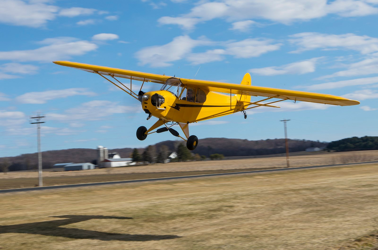 Owen Knutson seen flying a private plane in a previous flight; Courtesy: BanksPhotos.com
