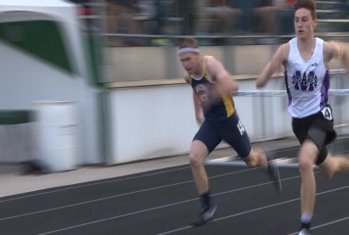 EC Memorial's Drake Schneider wins a close race in the boys 300 meter hurdles