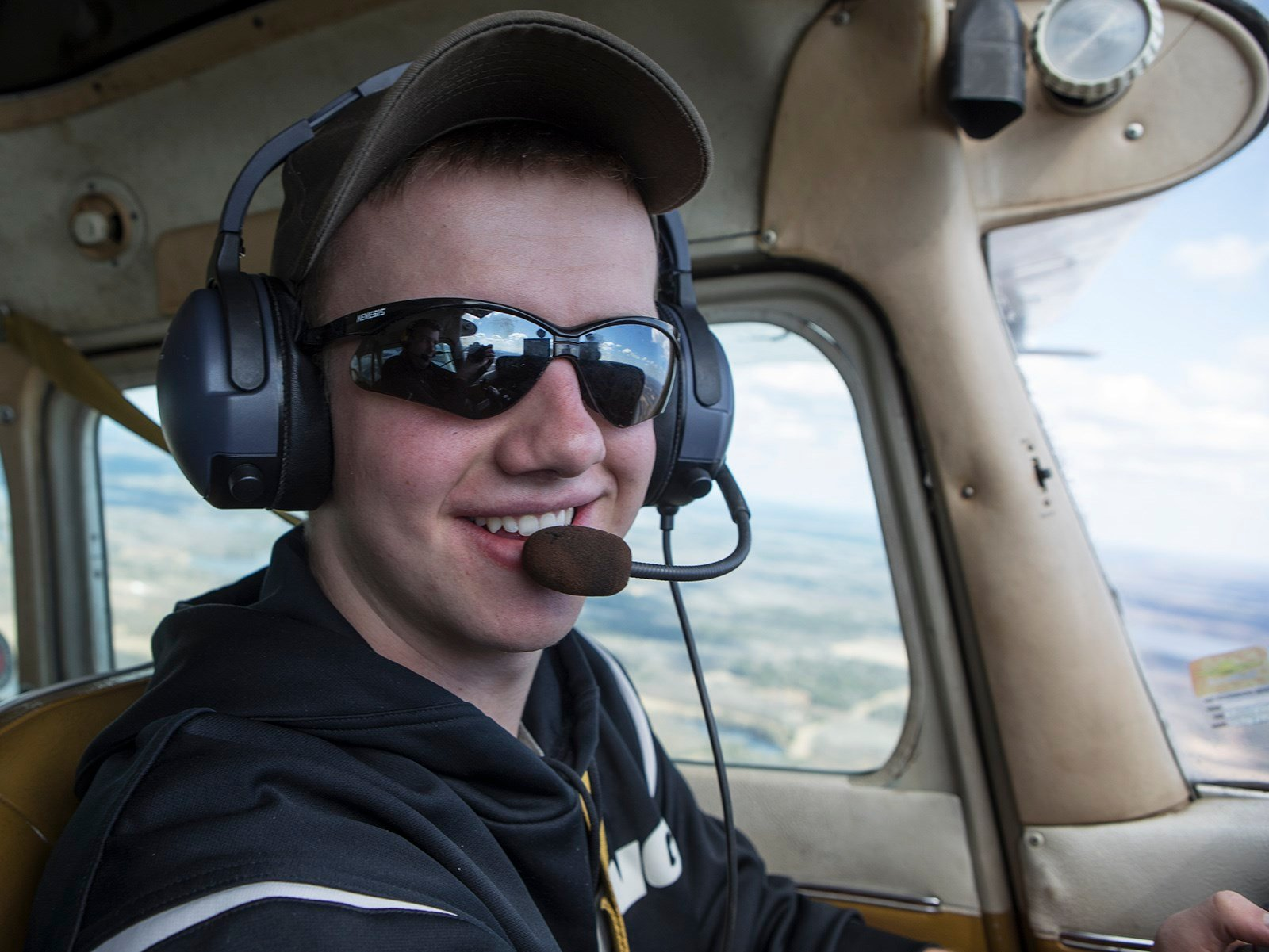 Owen Knutson flying a private plane. Courtesy: BanksPhotos.com