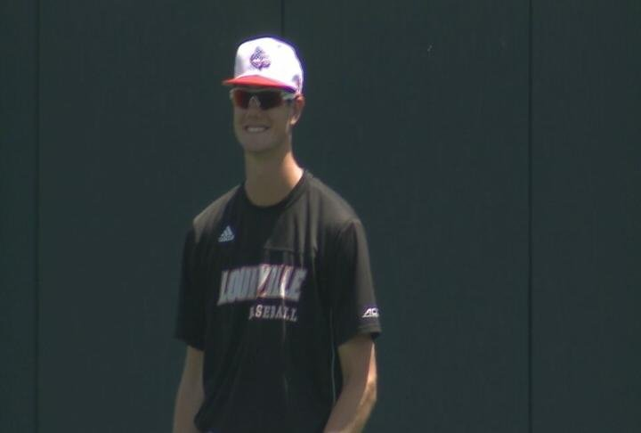 Jake Spartger & his Louisville teammates practice Friday at the College World Series