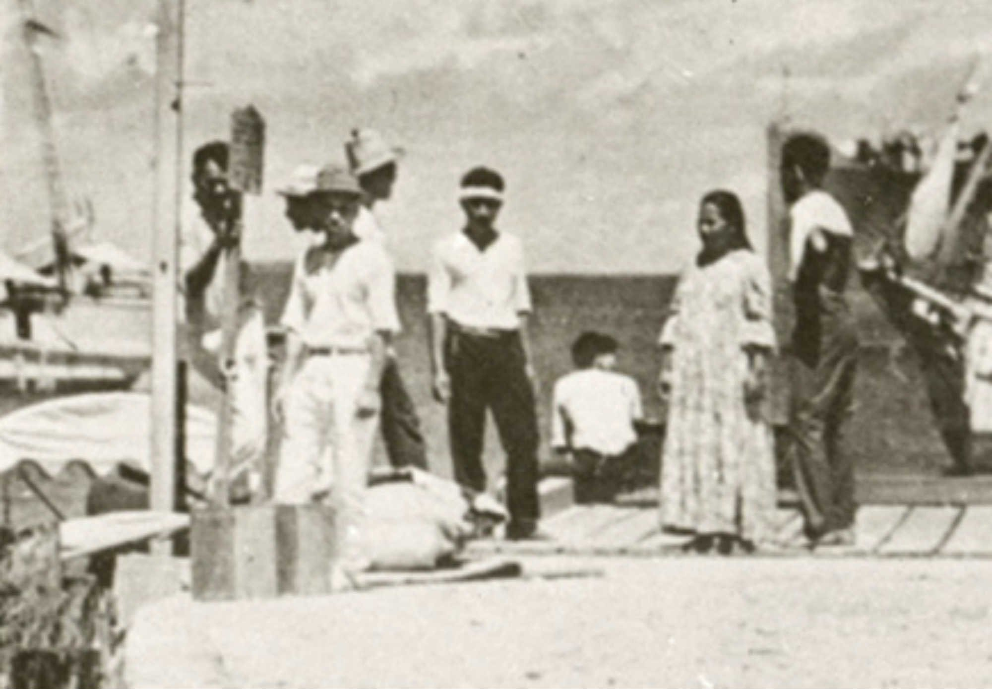 According to the new documentary, the person whose back is to the camera is Amelia Earhart. (Courtesy: National Archives photo)