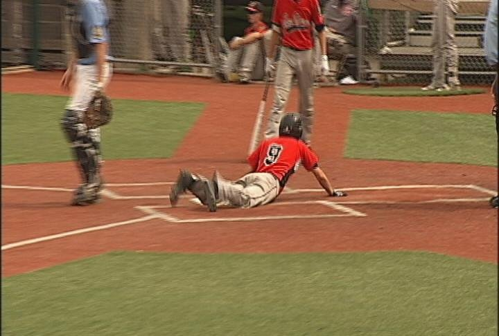 Kaz Palzkill scores the eventual game-winning run for Eau Claire