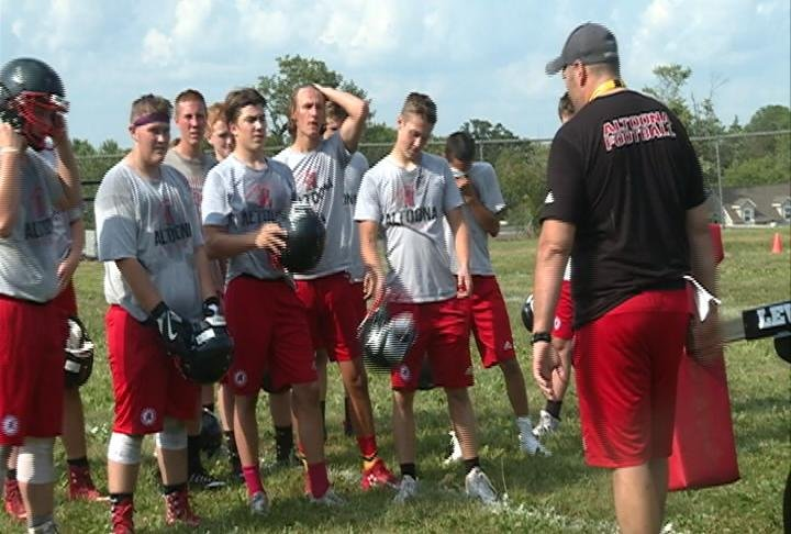 Altoona coach Steve English talks to his team