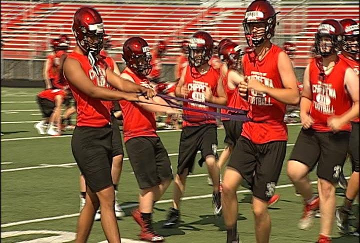 Chippewa Falls works out on the turf at Dorais Field