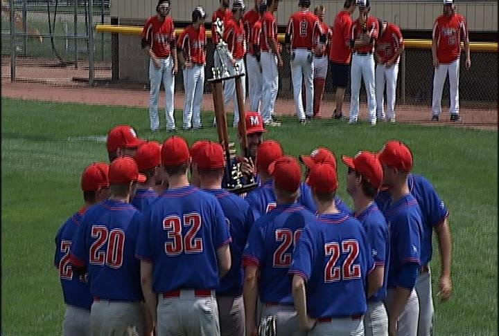 Merchants hoist the CRBL Championship Trophy