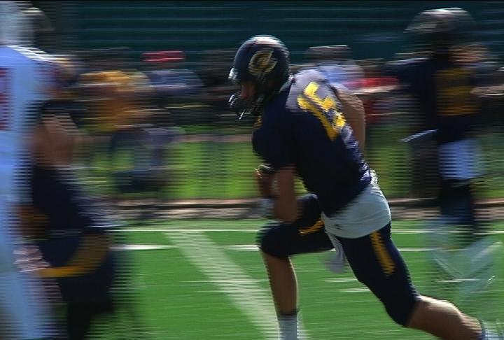 Quarterback JT DenHartog runs up the middle vs. River Falls