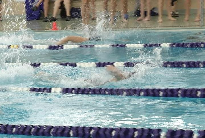 EC Memorial's Kate Augustyn wins the 50 freestyle