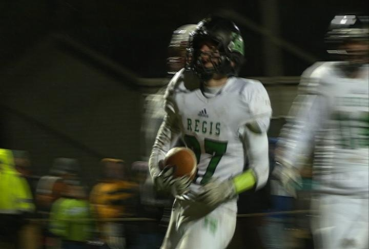 Andrew Root scores the opening TD as Regis rolls past Spring Valley