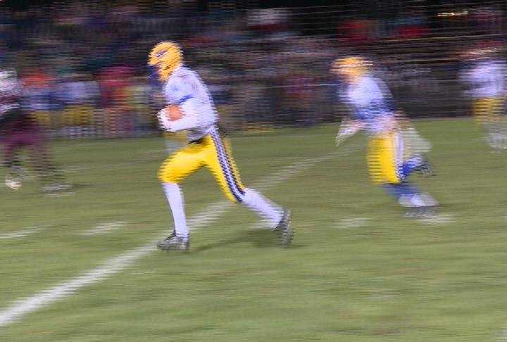 Warrior Sam Bliese returns an interception in Rice Lake's win over Antigo