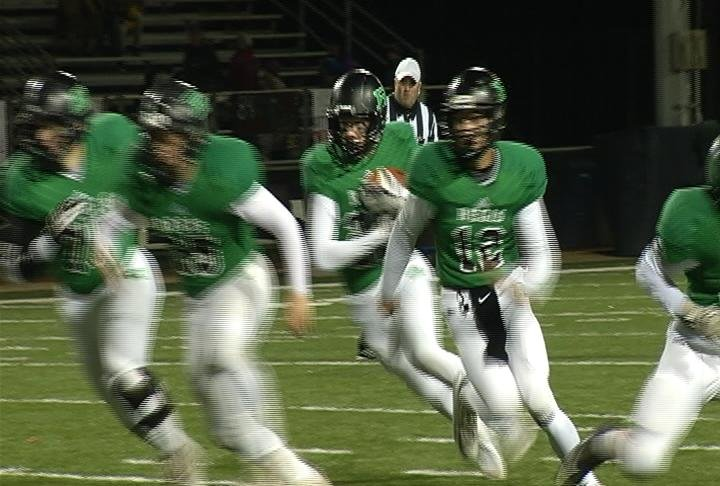 Hayden Reinders carries a handoff in Regis' win over Unity