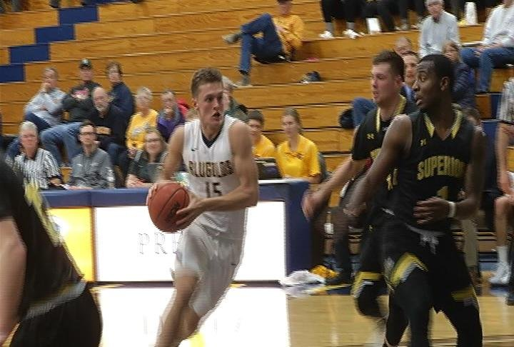 George Diekelman drives for 2 of his game-high 19 points
