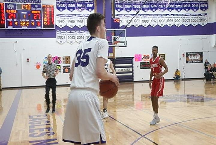 Caden Boser lines up a 3 as EC Memorial edges La Crosse Logan