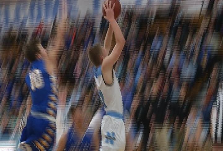 Noah Hanson scores as the Huskies top Rice Lake