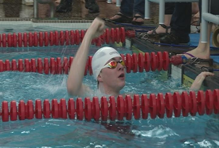 Jack Merkatoris celebrates the EC Alliance's 200 freestyle relay victory