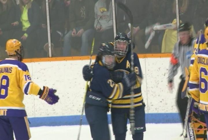 Colton Wolter celebrates a late first period goal, as the Blugolds tie the Pointers