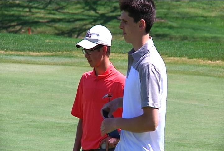 L to R: Osseo-Fairchild's Colin Sumner & Andrew Reis of McDonell/Regis shoot 80 & 86, respectively