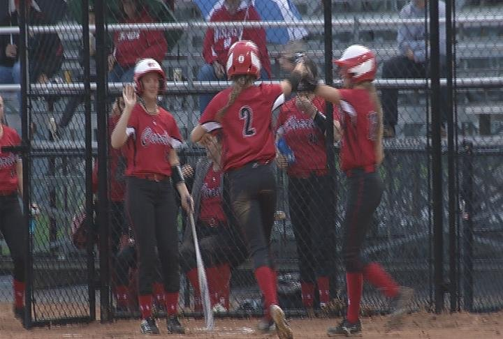 The Cardinals top the Old Abes in the rain at Gelein Field