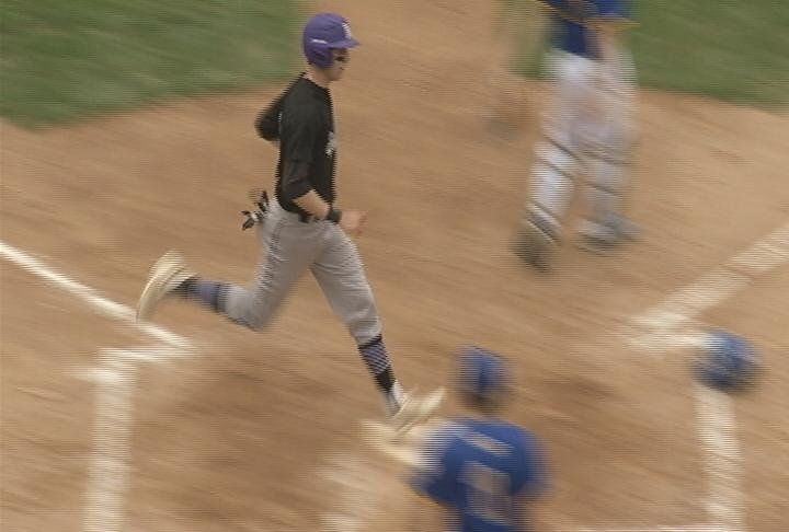 EC Memorial's Tanner Kohlhepp scores as part of a 6-run first inning for the Abes