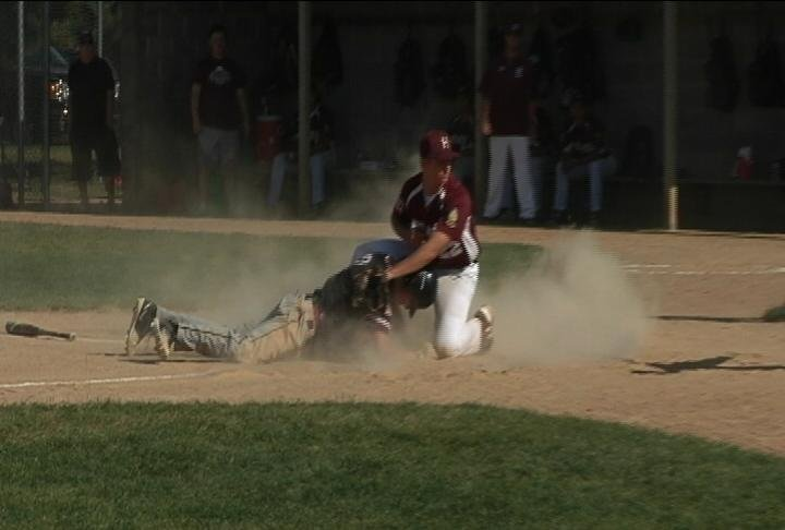 Luke Rooney slides in with Eau Claire's 4th run