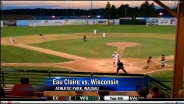 Ty Forney scores Eau Claire's 3rd run on a wild pitch