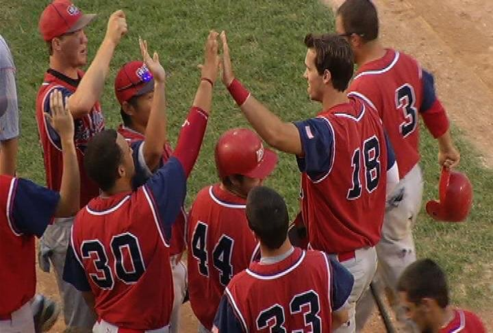 The Cavs congratulate Brian Burman (#18) after his 1st inning grand  slam