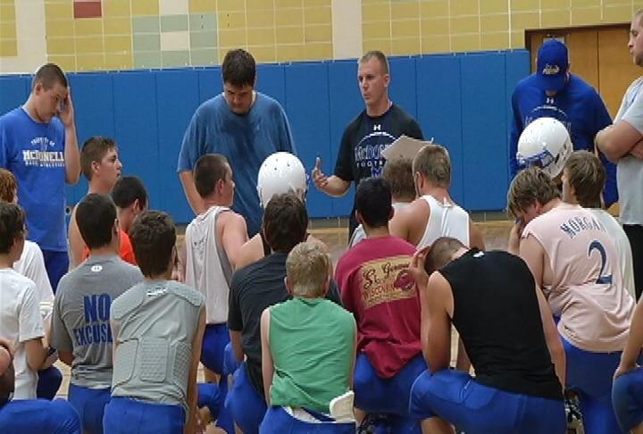 McDonell Central head coach Joe Salter addresses the Macks