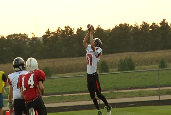 Elk Mound's Dakota Tarnow hauls in a pair of 1st half TD passes at Eleva-Strum