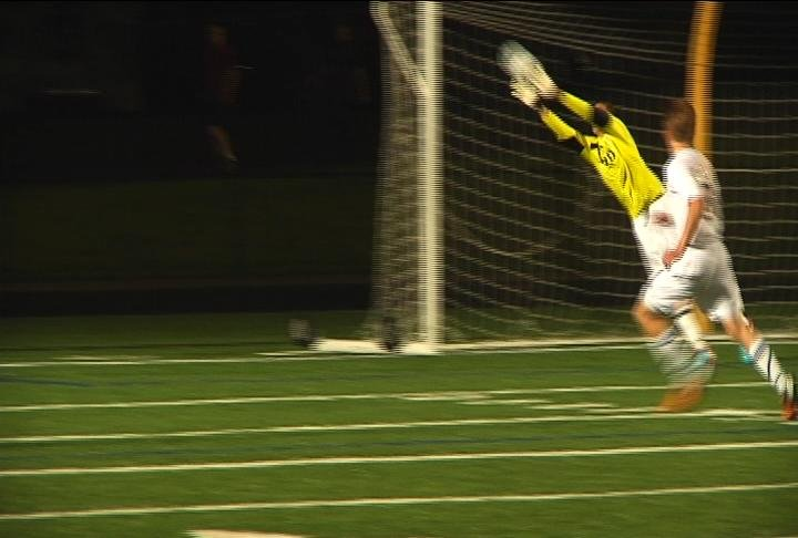 EC North goalkeeper Josh Weix stretches out for a save