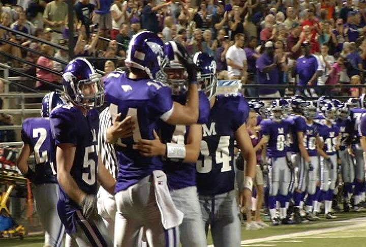 EC Memorial QB Ben Everhart (#14) celebrates a 4th quarter TD toss to Drew Davis (#11)