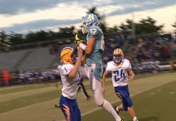 EC North's Anthony Miloszweicz makes a spectacular grab against Rice Lake
