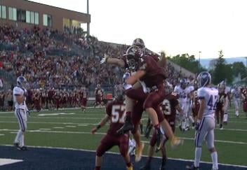 Menomonie celebrates a Cody Larson TD catch in a win over EC Memorial
