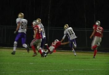 Durand's Jake Weber busts loose on a 95-yard punt return for a TD