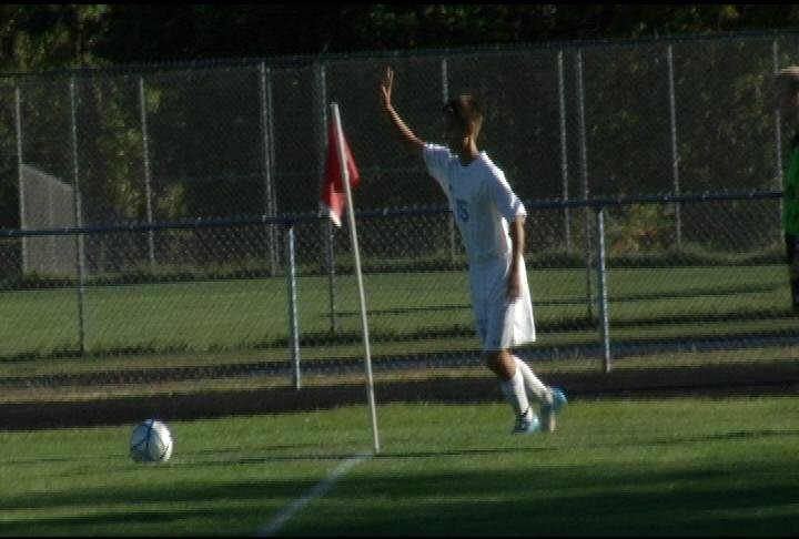 EC North's Derek Shimoda with the corner kick