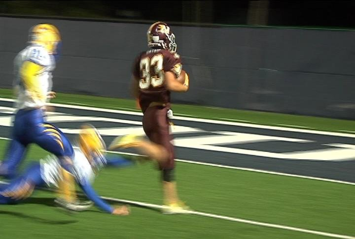Menomonie's James Gates goes in for a TD as the Mustangs defeat Rice Lake
