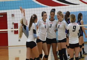 EC North celebrates a 3-0 sweep of EC Memorial