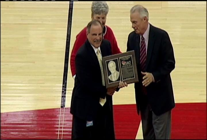 WIAC Commissioner presents UW coach Bo Ryan with his WIAC Hall of Fame plaque