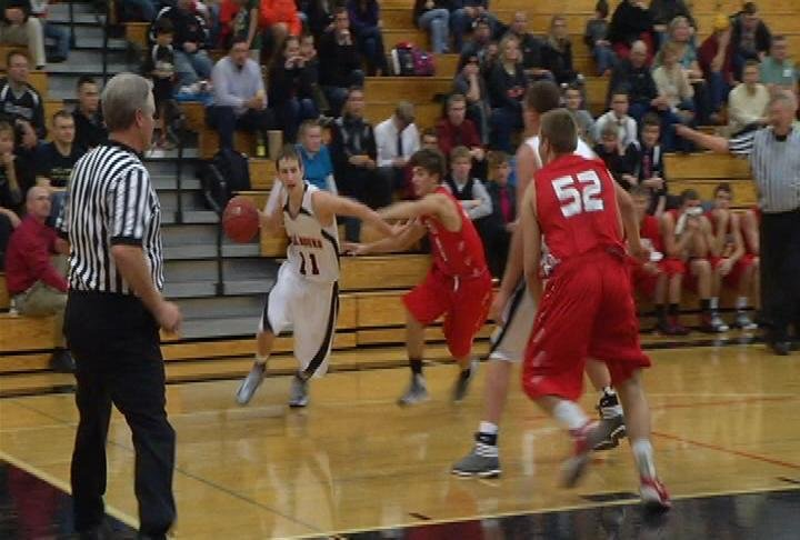 Elk Mound's Zac Doll drives to the hoop in a win over Eleva-Strum