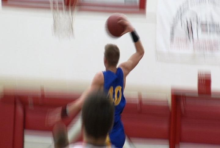 Rice Lake's Elwood Ellenson throws one down in a win at Chippewa Falls