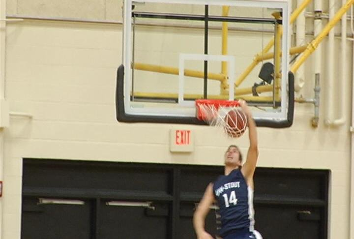UW-Stout's Alex Oman throws down a dunk in a win at UW-Superior