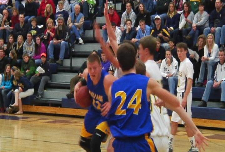 Rice Lake's Henry Ellenson drives the lane as the Warriors win at River Falls