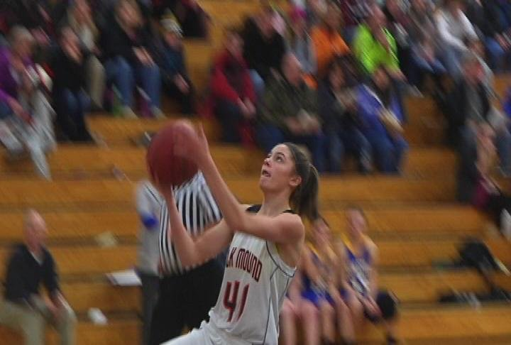 Kaysi Meindel finishes a fastbreak for Elk Mound