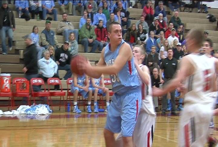 EC North's Ben Lawrence looks to pass the basketball in the Huskies' win at Chippewa Falls