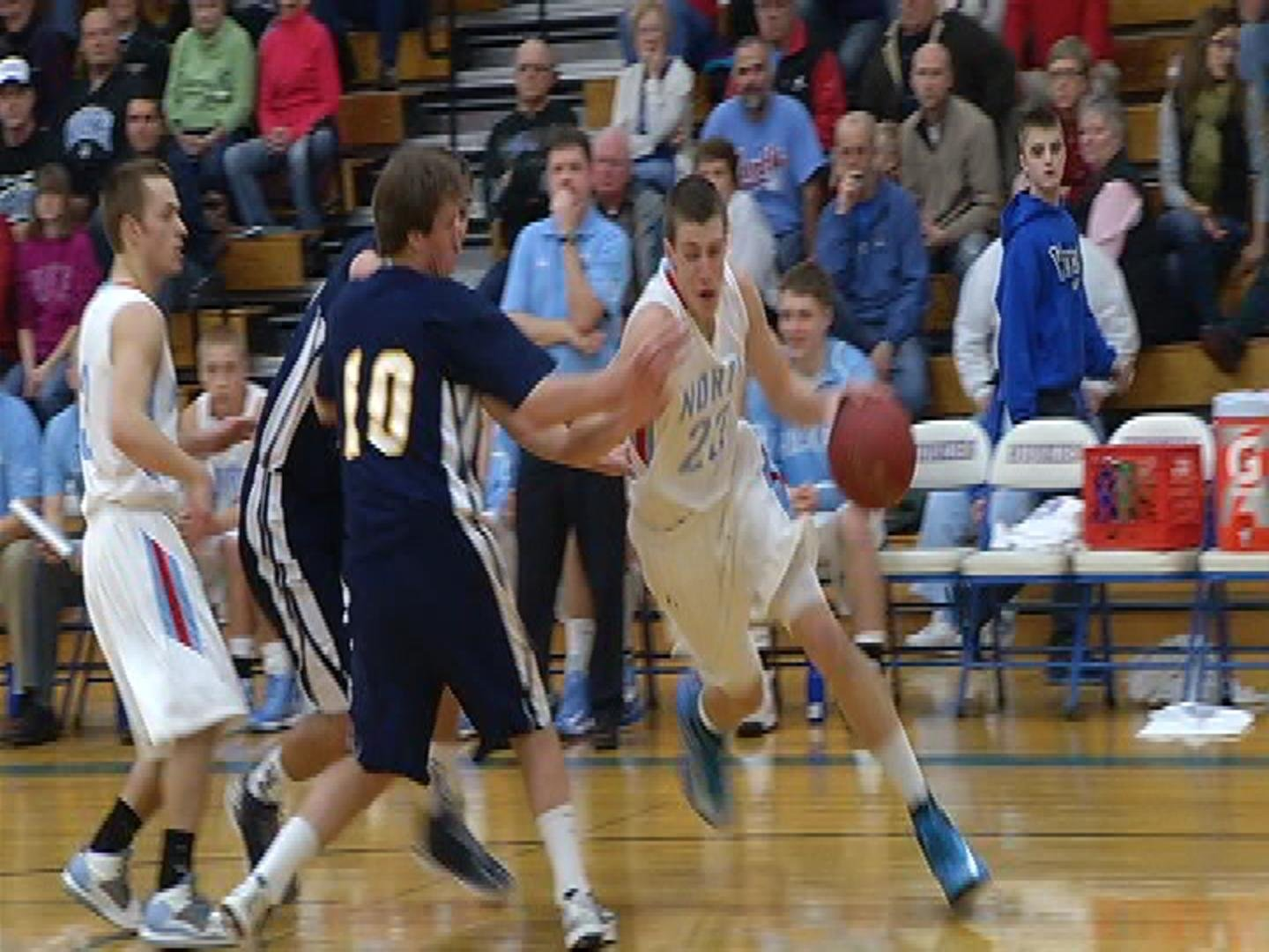 EC North's Josh Weix drives to the hoop for 2 of his team-high 11 in a win over River Falls